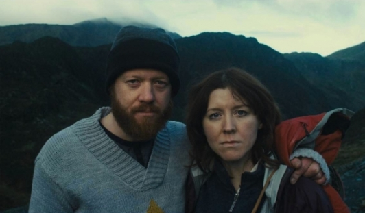 sightseers-2012-001-chris-and-tina-up-mountain-posing-to-camera_0
